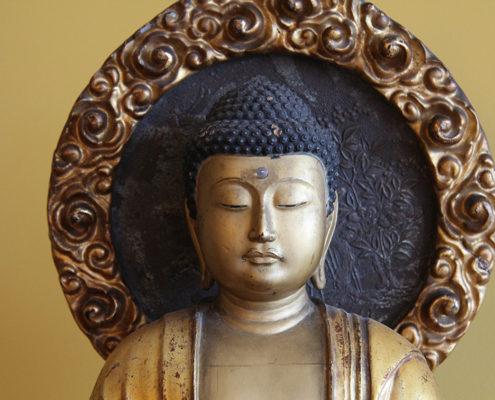Haut d'une sculpture de bouddha