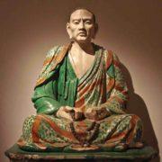 Photo d'une sculpture chinoise d'un méditant assis